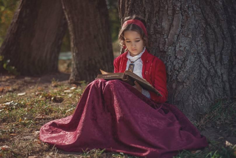 Child Reading Outside
